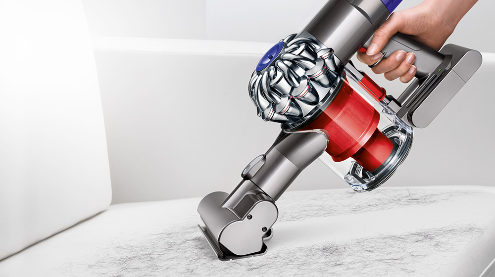 Dyson V6 Cord-free vacuuming a mattress in handheld mode.