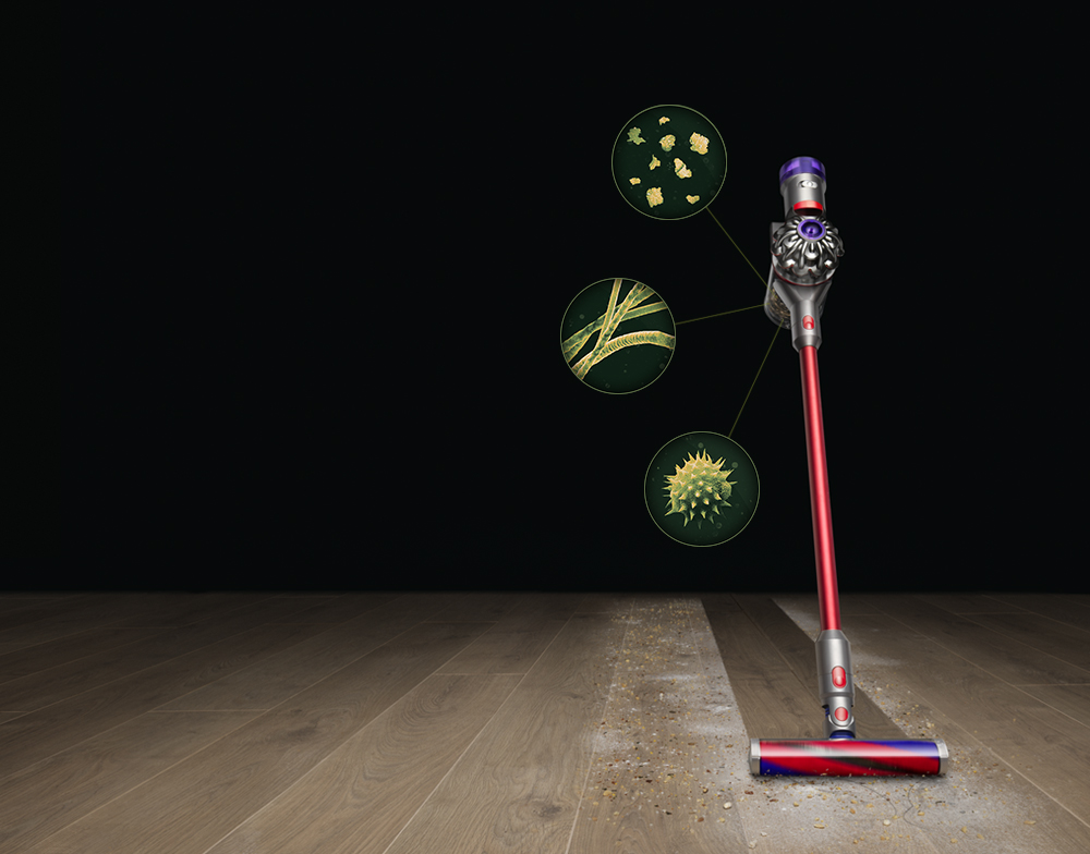 Dyson V8 Slim cleaning cleaning dust from a hard floor
